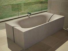 Concrete bathtub 1 photo-1 on Concrete bathtub & wash basin with undulating shapes and modern design - - image