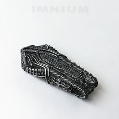 Black spaceship of doom Industrial wire wrapped pendant by IMNIUM