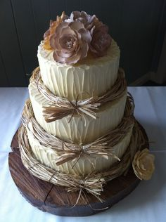 Rustic Wedding Cake — It is hard to set your cake apart from all the other beautiful cakes out there, but this one succeeds beautifully.