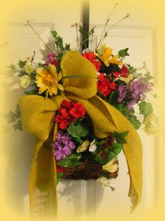 So Pretty !!! Yellow , purple, Red, white and mixed flowers....with mustard colored burlap bow...$29.99