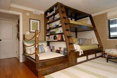 Bunk bed combo with shelving, big bed on bottom, and reading spot.