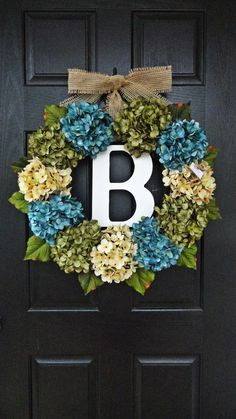 DIY hydrangea & initial wreath. Adorable, but I would use only green & off white.