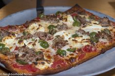 East Glisan's sausage, olive, ricotta cheese and polenta crust pizza