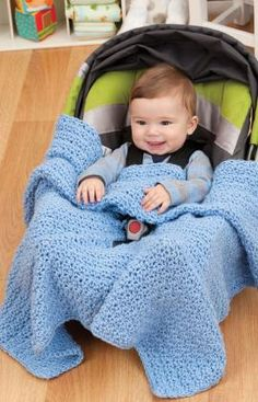 Car Seat Blanket Crochet PDF Pattern (Red Heart) - The nice thing about this crocheted blanket is that it stays where baby needs it. There are openings for the seat strap and the shoulder straps, so it's perfect for keeping baby snug and cozy while you keep your eyes on the road., Free