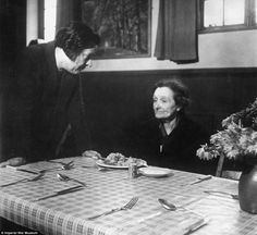 A woman made homeless by the Blitz receives a meal at a welfare centre in Bermondsey, London,1940. Cecil Beaton. (rw)