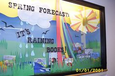 """""""Spring Forecast:  It's Raining Books!"""" library display"""