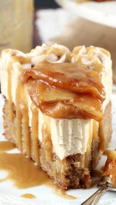 Caramel Apple Blondie Cheesecake | It's an apple spice blondie filled with apples, topped with a no bake caramel cheesecake, topped with cinnamon apples and even more caramel sauce. It's pure caramel apple heaven