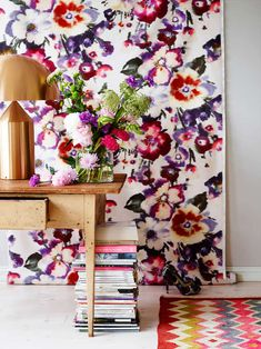 """A bolt of fabric hanging there?! Great idea for an apartment you can't paint or paper, or just a bold pattern you might tire of in the future. Just switch it out for the next """"bolt"""" of inspiration to strike your fancy."""