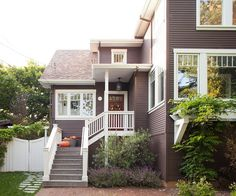 Slate-gray siding makes bright-white trim stand out. See 21 home projects you can do before Thanksgiving: http://www.bhg.com/home-improvement/advice/maintenance-repair/projects-to-consider-before-thanksgiving/?socsrc=bhgpin092112slategraysiding=14