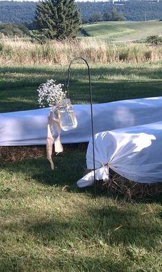 Shepard's hooks, burlap ties, mason jars, baby's breath, hay bale seating