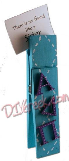 Painted clothes pin blue (easier to paint if you take apart first). Stenciled the stiched diamonds in white. Painted wood letters from supply sack purple and glued on   DIYGreek.com #alpha #delta #pi #lion #sorority #craft #sister #greek