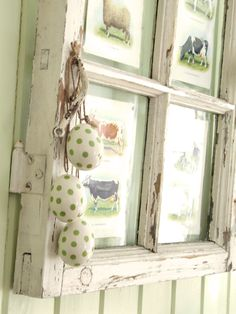 love this sweet little old window with the pictures behind it