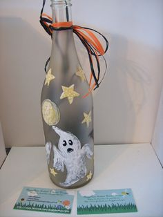 "Bottle of ""Boos"" hand painted wine bottle with lights and black and orange bow...decorated with bats, ghosts and black cat... http://www.facebook.com/buggybeandesigns"