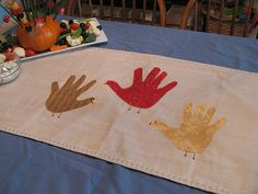 How to: Handprint Turkey Thanksgiving Table Runner--or use fabric and iron on @Paula mcr Trentman looooove this!