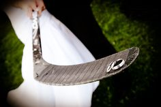 Wedding Rings on a hockey stick