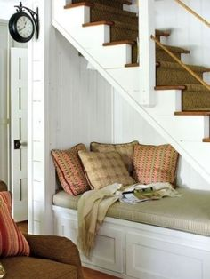 Another cool use of the under stairs space. Book nook