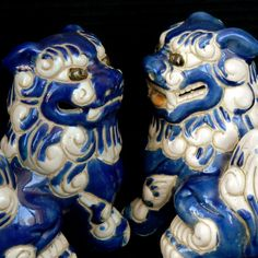 Vintage blue and white foo dog pair with gold good luck coin
