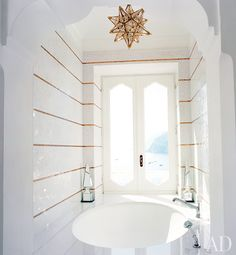 bathroom tile - use small mosaic tiles to create visual interest.  cheaper than an accent wall