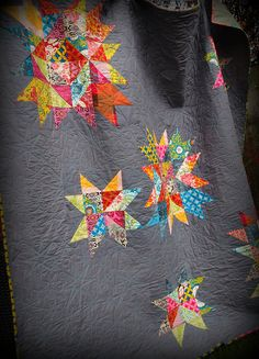 grey with bright quilt