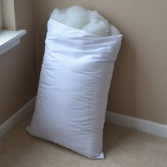 buy cheap pillows and use the stuffing! cheaper than buying a bag of stuffing.    note from Hannah, I thought of this today when I bought two large pillow from Walmart for 3.50 each instead of buying two ten dollar bags of stuffing for a project....LOL