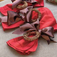 Napkin Ring Wreath | Use small-scale wreaths to decorate your table. Simply tie tiny grapevine wreaths to napkins using a pretty, color-coordinated ribbon. | SouthernLiving.com