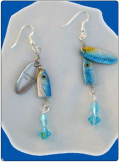 http://diginanchors.com/EarringsAlure_DangleBlueSpinner - Dangling earrings handmade with beautifully blue finished, high quality lures. Added to each fishing lure is sparkling, light blue and aquamarine beads and crystals matching the color of the lure.The earring are 3 and 1/4 inches long. The unique earrings are hung on silver plated earwires made with surgical stainless steel.