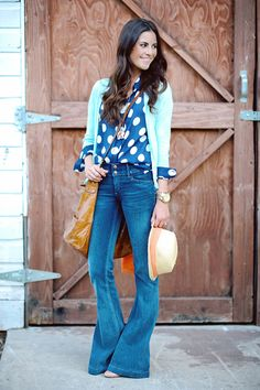 Such a cool, unexpected combination...navy polka dot blouse, aqua cardi, wide leg jean, large leather bag