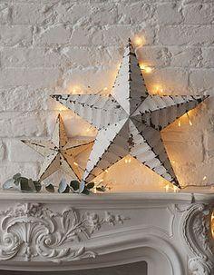 back-lit rustic tin star