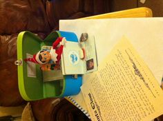 """Day 4 - Letter from Santa explaining how he believes in Jesus and Toz pulled map out at Santa's request so she's see all the places children live that Santa visits and who need Jesus. (Suitcase, passport and map courtesy of subscription to """"Little Passports"""" International.)"""