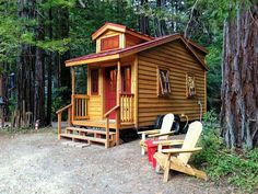 Craftsman style tiny house with red accents