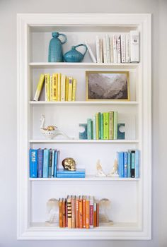Sally Wheat Interiors, Domino Magazine, color coded bookshelf