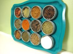 DIY magnetic spice rack. This is cute, but I have a lot of spices. I would need many many many metal trays.