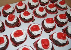 fireman hat cupcakes for a firetruck themed baby shower by Simply Sweets, via Flickr