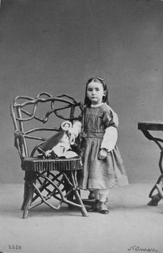 Girl with doll, ca. 1860s.