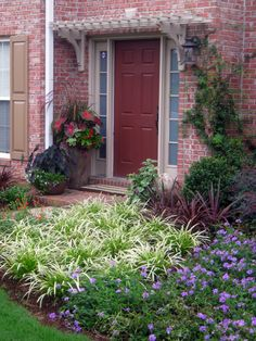 Love the color and the simple wooden arbor above the front door.