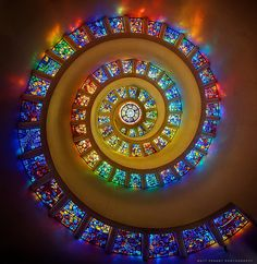 Thanksgiving Square Chapel by Matt Pasant: The Glory Window which forms the 60-foot-high ceiling of the Chapel of Thanksgiving, is one of the largest horizontally mounted stained-glass pieces in the world. Designed by French artist Gabriel Loire, the window symbolizes the blessing of the Divine descending to earth as well as the ascent of human praise and gratitude to God. - Thanksgiving.org #Glory_Window #Thanksgiving_Square_Chapel #Dallas #Matt_Pasant