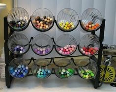 organize markers with cups and wine rack