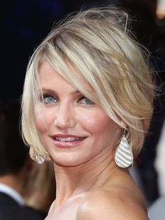 Cameron Diaz choppy bob haircut  mist texturizing spray while hair is wet, use small vented brush with blow drying bangs to one side, let rest air dry, bangs hit around bottom of nose, cut into the ends to make it look carefree, should fall just below chin for square jaw, hover above chin for round