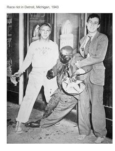 Race Riots in Detroit, Michigan (1943). Smiling for the camera while holding an innocent victim with a severed arm