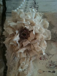 Shabby rag flower, enhanced with a little lace and beautiful pinkish bead cluster in the center.