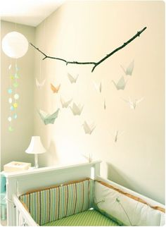 Origami Mobile would be a peaceful and cute touch to a nursery room~