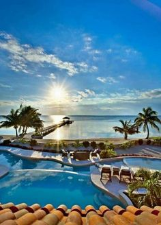 Sounds romantic to us: Spectacular views and manicured grounds lend a hand for a relaxing vacation in Belize.