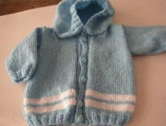 This Baby Hoodie is a super easy knit that only takes one or two balls of yarn to complete. Make a bunch and keep them on hand for baby showers. Learn how to knit this cute hoodie with this tutorial.