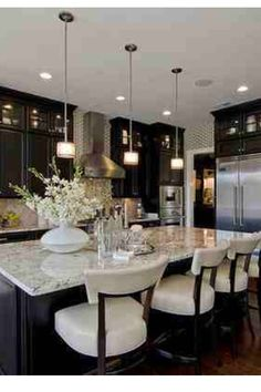 Love the rich look of the dark cabinets paired with the light granite color