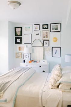 @Danielle Lampert Moss Chicago Home Tour // bedroom // gallery wall // white // photography by Stoffer Photography
