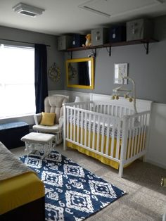 This #navy #Ikat rug pairs so well with #gray walls and #yellow accents.  #graphicrug #nursery