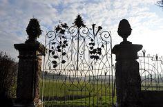 wood gate, artist iron, iron gates