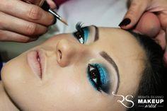 Black and vibrant blue makeup