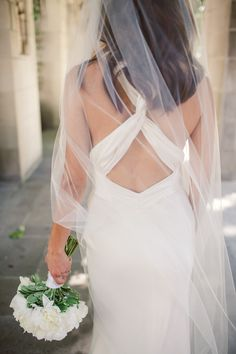 Crossed back Nicole Miller wedding dress | Photography: dluphotography.com