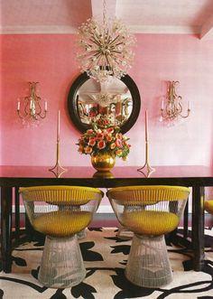 pink walls. yellow chairs